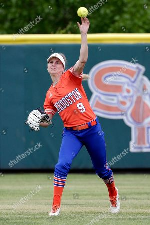 Sam Houston State outfielder Megan McDonald fields a hit from Houston Baptist during an NCAA softball game on in Huntsville, Texas