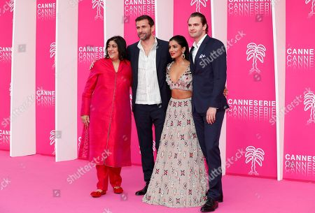 Cast members of 'Beecham House', British director Gurinder Chadha (L), French actor Gregory Fitoussi (2-L), Australian actress Pallavi Sharda (2-R) and British actor Tom Bateman (R) pose on the pink carpet during the Cannes Series Festival in Cannes, 07 April 2019. The event will take place from 05 to 10 April.
