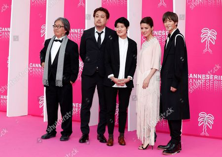 Cast members of 'Junichi', Japanese directors Eiji Kitahara (2-L), Nanako Hirose (C), Japanese actors Fujii Mina (2-R), Jun Shison (R) pose on the pink carpet during the Cannes Series Festival in Cannes, 07 April 2019. The event will take place from 05 to 10 April.