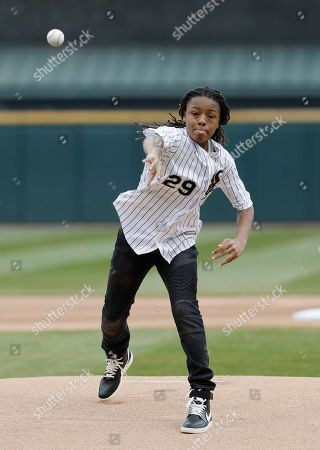 Actor Michael Epps throws out the ceremonial first pitch before a baseball game between the Seattle Mariners and the Chicago White Sox in Chicago