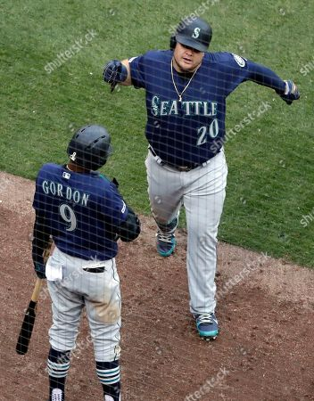 Daniel Vogelbach, Dee Gordon. Seattle Mariners' Daniel Vogelbach, right, celebrates with Dee Gordon after hitting a solo home run against the Chicago White Sox during the ninth inning of a baseball game in Chicago