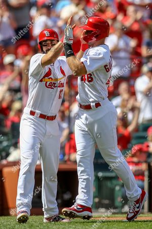 St. Louis Cardinals' Matt Carpenter, left, and Paul Goldschmidt celebrate after scoring on a double by Paul DeJong during the fourth inning of a baseball game against the San Diego Padres, in St. Louis