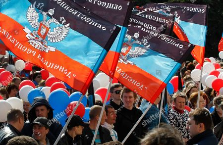 Locals wave flags as they celebrate the fifth anniversary of the creation of the self-proclaimed Donetsk People's Republic (DPR) in the pro-Russian militants controlled city of Donetsk, Ukraine, 07 April 2019. Pro-Russian protestors occupied the regional administration building in Donetsk on 07 April 2014 and a decision about a referendum on self-determination was adopted.