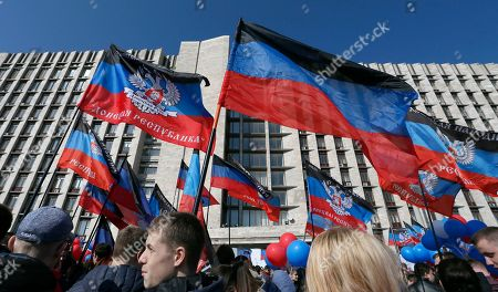 Stock Photo of Locals wave flags as they celebrate the fifth anniversary of the creation of the self-proclaimed Donetsk People's Republic (DPR) in the pro-Russian militants controlled city of Donetsk, Ukraine, 07 April 2019. Pro-Russian protestors occupied the regional administration building in Donetsk on 07 April 2014 and a decision about a referendum on self-determination was adopted.