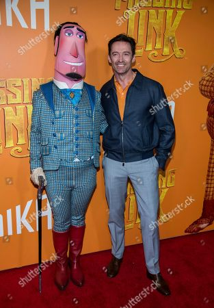 """Hugh Jackman poses with a costumed character from the film at the premiere of """"Missing Link"""" at Regal Cinemas Battery Park, in New York"""