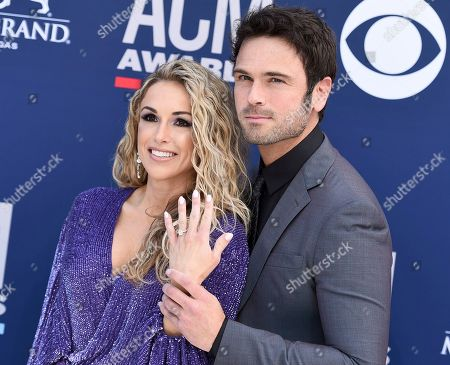 Chuck Wicks, Kasi Williams. Chuck Wicks, right, and Kasi Williams show off an engagement ring as they arrive at the 54th annual Academy of Country Music Awards at the MGM Grand Garden Arena, in Las Vegas