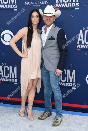 Stock Picture of Justin Moore, Kate Moore. Justin Moore, right, and Kate Moore arrive at the 54th annual Academy of Country Music Awards at the MGM Grand Garden Arena, in Las Vegas