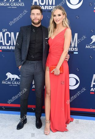 Chris Lane, Lauren Bushnell. Chris Lane, left, and Lauren Bushnell arrive at the 54th annual Academy of Country Music Awards at the MGM Grand Garden Arena, in Las Vegas