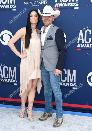Stock Photo of Justin Moore, Kate Moore. Justin Moore, right, and Kate Moore arrive at the 54th annual Academy of Country Music Awards at the MGM Grand Garden Arena, in Las Vegas