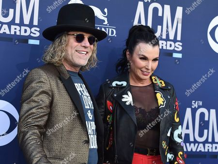 Big Kenny, Christiev Carothers. Big Kenny, left, and Christiev Carothers arrive at the 54th annual Academy of Country Music Awards at the MGM Grand Garden Arena, in Las Vegas