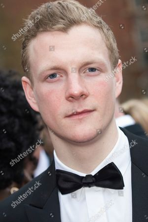 Patrick Gibson poses for photographers upon arrival at the Olivier Awards in London