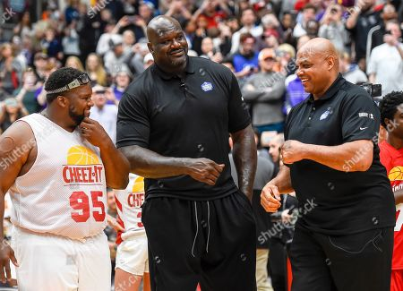 Shaquille O'Neal, Charles Barkley. Shaquille O'Neal and Charles Barkley fist bump at the Celebrity Crunch Classic presented by Cheez-It and Pringles, in St Paul, Minn