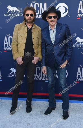Ronnie Dunn, Kix Brooks. Ronnie Dunn, left, and Kix Brooks, of Brooks & Dunn, arrive at the 54th annual Academy of Country Music Awards at the MGM Grand Garden Arena, in Las Vegas