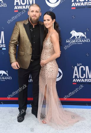 Brantley Gilbert, Amber Cochran. Brantley Gilbert, left, and Amber Cochran arrive at the 54th annual Academy of Country Music Awards at the MGM Grand Garden Arena, in Las Vegas