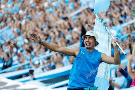 Racing Club's fans jubilate the victory of the team during a Superliga match between Racing Club and Defensa y Justicia, at the Juan Domingo Peron de Avellaneda stadium, in Buenos Aires, Argentina, 07 April 2019.