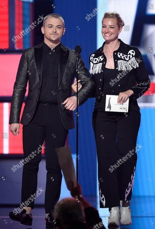 Hunter Hayes, Beth Behrs. Hunter Hayes, left, and Beth Behrs walk on stage to present the award for male artist of the year at the 54th annual Academy of Country Music Awards at the MGM Grand Garden Arena, in Las Vegas