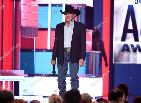 George Strait presents the Dick Clark artist of the decade award at the 54th annual Academy of Country Music Awards at the MGM Grand Garden Arena, in Las Vegas