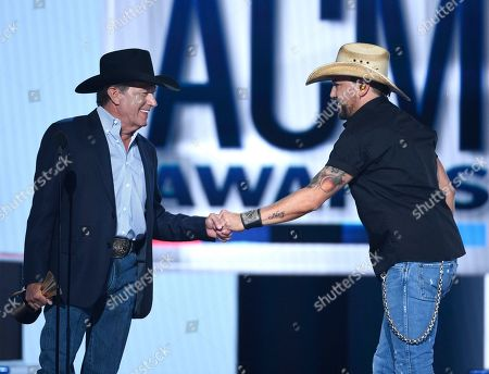 Jason Aldean, George Strait. George Strait, left, presents Jason Aldean with the Dick Clark artist of the decade award at the 54th annual Academy of Country Music Awards at the MGM Grand Garden Arena, in Las Vegas