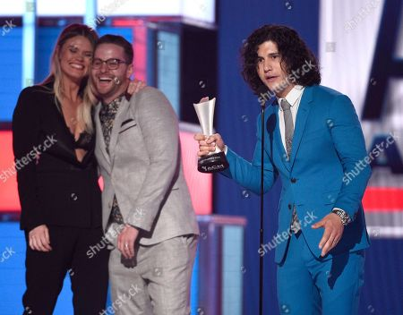 "Stock Picture of Dan Smyers, Nicolle Galyon, Jordan Reynolds. Dan Smyers, of Dan + Shay, accepts the award for song of the year for ""Tequila"" as Nicolle Galyon, from left, and Jordan Reynolds look on at the 54th annual Academy of Country Music Awards at the MGM Grand Garden Arena, in Las Vegas"