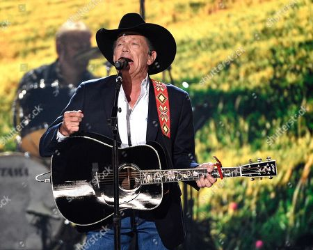 """George Strait performs """"God and Country Music"""" at the 54th annual Academy of Country Music Awards at the MGM Grand Garden Arena, in Las Vegas"""