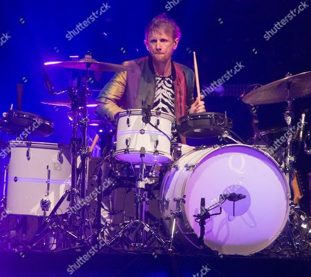 """Dominic Howard of the band Muse performs in concert during their """"Simulation Theory World Tour"""" at The Wells Fargo Center, in Philadelphia"""