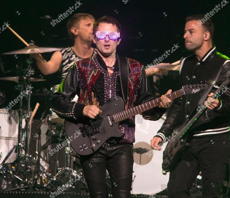 "Dominic Howard, Matt Bellamy, Chris Wolstenholme. Dominic Howard, left, Matt Bellamy and Chris Wolstenholme of the band Muse perform in concert during their ""Simulation Theory World Tour"" at The Wells Fargo Center, in Philadelphia"