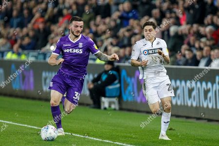 Tom Edwards of Stoke City and Daniel James of Swansea City