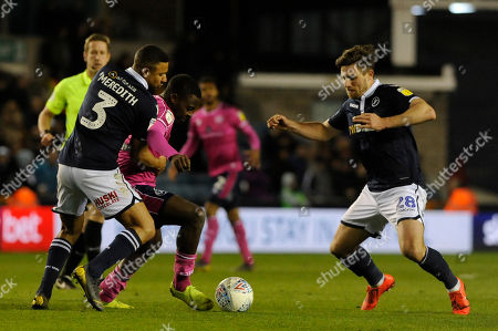 James Meredith of Millwall and Bright Osayi-Samuel  of Queens Park Rangers in action during the Sky Bet Championship match between Millwall and Queens Park Rangers at The Den in London, UK -  10th April 2019