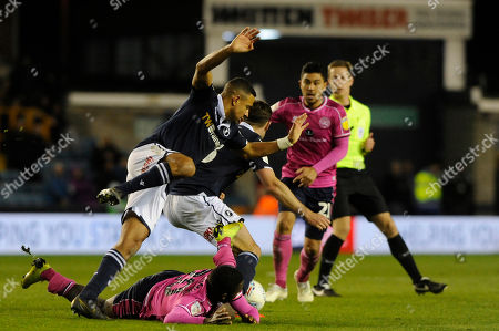 James Meredith (L) and Ryan Leonard (C) of Millwall and Bright Osayi-Samuel  (Bottom)  of Queens Park Rangers in action during the Sky Bet Championship match between Millwall and Queens Park Rangers at The Den in London, UK -  10th April 2019