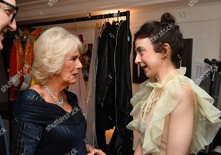 Camilla Duchess of Cornwall talks to Patsy Ferran, winner of the best actress award, after attending the Olivier Awards at the Royal Albert Hall