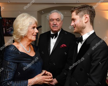 Stock Image of Camilla Duchess of Cornwall talks to Kyle Soller, winner of the best actor award, after attending the Olivier Awards at the Royal Albert Hall