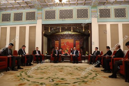 Karim Massimov (C-L), chairman of the National Security Council of Kazakhstan, talks with Chinese Vice President Wang Qishan (C-R) during their meeting at Zhongnanhai in Beijing, China, 08 April 2019.