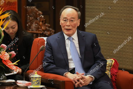 Chinese Vice President Wang Qishan talks with Karim Massimov (not pictured), chairman of the National Security Council of Kazakhstan, during their meeting at Zhongnanhai in Beijing, China, 08 April 2019.