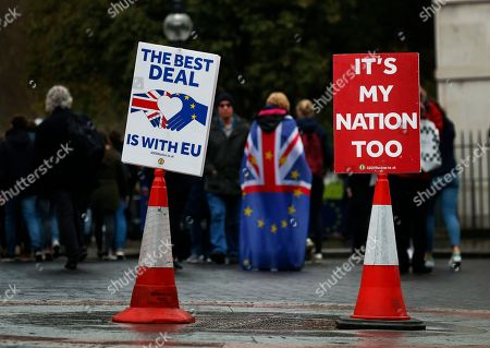 Pro EU protestors demonstrate opposite the Houses of Parliament in London, . Britain's government and opposition party are hoping to find a compromise Brexit deal ahead of further talks with European Union leaders