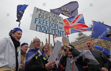 Pro EU protestors and singers of a choir perform opposite the Houses of Parliament in London, . Britain's government and opposition parties are clinging to hope Monday of finding a compromise Brexit deal