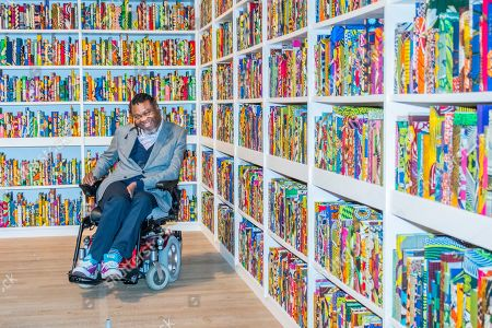 The British Library an installation by Yinka Shonibare CBE (pictured with his work), at Tate Modern, having just been acquired by them. Highlighting the impact of immigration on British culture, it is a site-specific installation with a digital platform for visitors to join in the discussion.