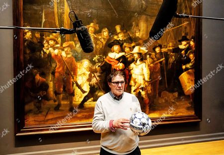 Stock Image of Former Dutch soccer player Willem van Hanegem poses for photographers with the new official matchball of the Dutch Eredivisie at the Rijksmuseum in Amsterdam, Netherlands, 08 April 2019.
