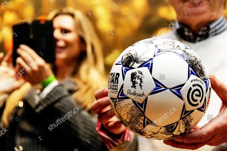 Stock Picture of Former Dutch soccer player Willem van Hanegem poses for photographers with the new official matchball of the Dutch Eredivisie at the Rijksmuseum in Amsterdam, Netherlands, 08 April 2019.
