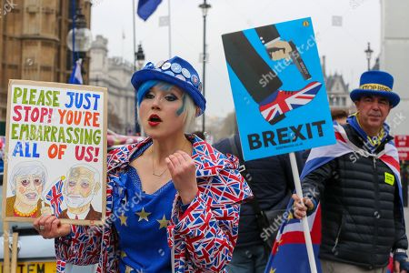 Stock Picture of Madeleina Kay, an anti-Brexit and Steve Bray, an anti-Brexit protesters demonstrating outside the Houses of Parliament. British Prime Minister, Theresa May will travel to Berlin and Paris on Tuesday, 9 April to meet with Chancellor of Germany - Angela Merkel and President of the French - Emmanuel Macron ahead of a crunch Brexit summit in Brussels on Wednesday, 10 April.