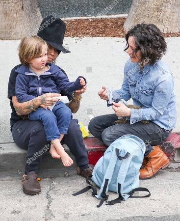 Stock Image of Linda Perry, Sara Gilbert with son Rhodes