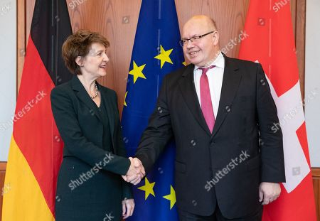 Minister of Economics and Energy Peter Altmaier (R) and Member of the Swiss Federal Council Simonetta Sommaruga (L) shake hands during their meeting at the German Federal Ministry for Economic Affairs and Energy in Berlin, Germany, 08 April 2019.