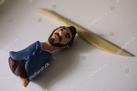 Stock Photo of Egyptian artist Fady Francis shows a miniature statue of Nicholas James Vujicic an Australian Christian evangelist at his home in Cairo, Egypt, 06 April 2019 (issued 08 April 2019). Fady Francis is a fine artist and journalist. He only started making miniature statues less than a year for local and international famous figures.