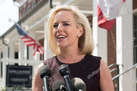 Homeland Security Secretary Kirstjen Nielsen talks outside her home in Alexandria, Va., on . Nielsen says she continues to support the president's goal of securing the border in her first public remarks since her surprise resignation