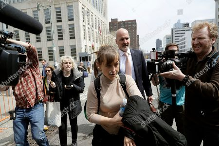 Actress Allison Mack leaves Brooklyn federal court, in New York. Mack pleaded guilty to racketeering charges on Monday in a case involving a cult-like group based in upstate New York. The trial is expected to detail sensational allegations that the group, called NXIVM, recruited sex slaves for its spiritual leader, Keith Raniere