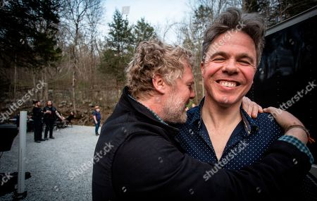 Underground cavern concert in Tennessee draws hundreds to hear Josh Ritter, Glen Hansard and Amanda Shires. Grammy-winning Irish singer/songwriter Glen Hansard, left, enjoys a light moment with American singer/songwriter Josh Ritter is seen before entering a cavern for an underground performance at The Caverns,, in Pelham, Tenn. The concert was part of the Emmy Award-winning PBS series, Bluegrass Underground, and took place in a subterranean venue that lies in an ancient cove with bats, salamanders and no cell phone service