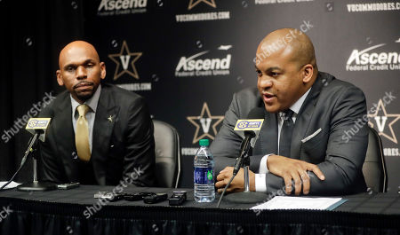 Vanderbilt basketball coach Jerry Stackhouse, left, listens as Athletics Director Malcom Turner, right, answers a question during a news conference, in Nashville, Tenn. Stackhouse was hired to replace Bryce Drew as head coach April 5