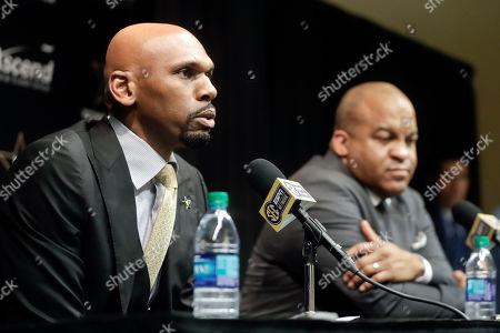 Vanderbilt basketball coach Jerry Stackhouse, left, answers questions during a news conference, in Nashville, Tenn. Stackhouse was hired to replace Bryce Drew as head coach April 5. At right is Athletics Director Malcom Turner