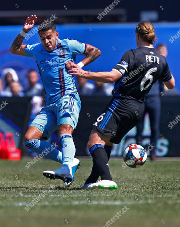New York City FC defender Ronald Matarrita (22) defends against Montreal Impact midfielder Samuel Piette (6) during the first half of an MLS soccer match, in New York