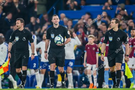 Christopher Kavanagh (Referee) with Dan Cook (Assistant Referee) & Constantine Hatzidakis (Assistant Referee) during the Premier League match between Chelsea and West Ham United at Stamford Bridge, London