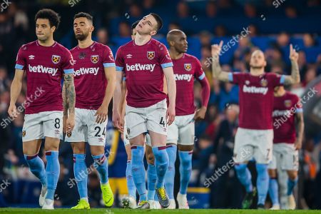 Declan Rice (West Ham) stretching his neck during the Premier League match between Chelsea and West Ham United at Stamford Bridge, London